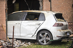 September 5, 2017 - York, Yorkshire, UK - York UK. The car that crashed into a house in York on Sunday has been removed this morning revealing the damage caused to the inside of the property. The car crashed through the wall into the living room then caught fire & caused a blaze in the the house, the crash injured four people including a man who was sat in the front room of the property at the time of the incident. (Credit Image: © Andrew Mccaren/London News Pictures via ZUMA Wire)
