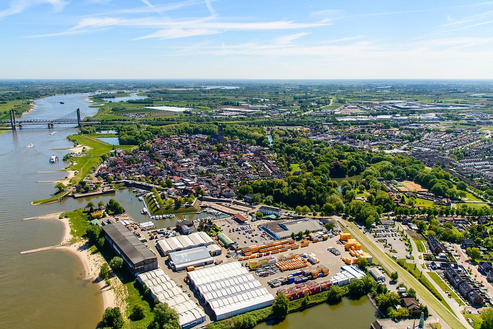 Nederland, Gelderland, West-Betuwe, 13-05-2019; Zaltbommel. bedrijventerrein aan de Gamerschedijk, westkant van de stad. Zicht op het centrum en rivier de Waal.<br /> Zaltbommel. Industrial estate, west side of the city. View of the city center and the river Waal.<br /> <br /> luchtfoto (toeslag op standard tarieven);<br /> aerial photo (additional fee required);<br /> copyright foto/photo Siebe Swart