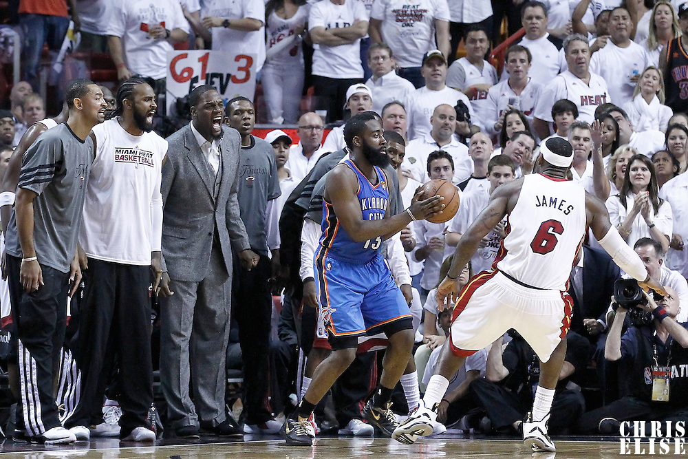 21 June 2012: Miami Heat power forward Juwan Howard (5), Miami Heat center Ronny Turiaf (21) and Miami Heat center Eddy Curry (34) scream from the bench while `Miami Heat small forward LeBron James (6) defends on Oklahoma City Thunder guard James Harden (13) during the Miami Heat 121-106 victory over the Oklahoma City Thunder, in Game 5 of the 2012 NBA Finals, at the AmericanAirlinesArena, Miami, Florida, USA. The Miami Heat wins the series 4-1.