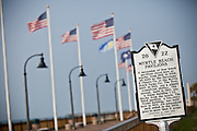 Historic marker on the boardwalk along the beachfront in Myrtle Beach, SC.