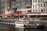 Cafes and sailboats on the harbor, Honfleur, Normandy, France