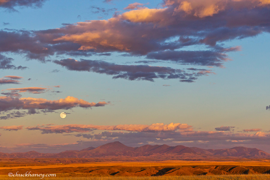 Full moon rises above the Highwood Mountains near Great Falls, Montana, USA