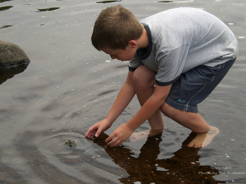 My nephew attempting to catch a frog.