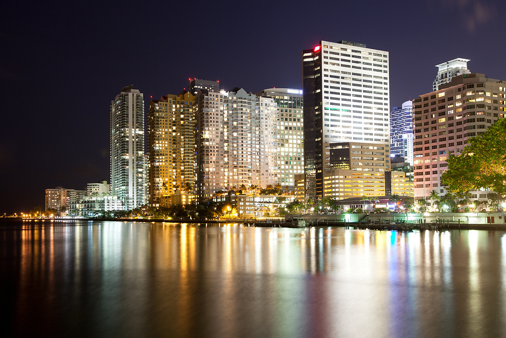 Skyline of apartment buildings at Brickell district in Miami at night, Florida, USA