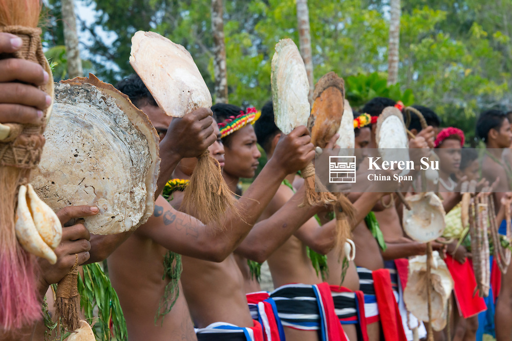 Yapese men holding Yar, shell money at Yap Day Festival, Yap Island, Federated States of Micronesia