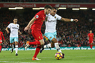 Adam Lallana of Liverpool and Dimitri Payet of West Ham United battle for the ball. Premier League match, Liverpool v West Ham Utd at the Anfield stadium in Liverpool, Merseyside on Sunday 11th December 2016.<br /> pic by Chris Stading, Andrew Orchard sports photography.