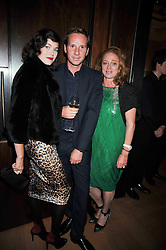 Left to right, JASMINE GUINNESS, her husband GAWAIN RAINEY and CAMILLA LOWTHER at fundraising dinner and auction in aid of Liver Good Life a charity for people with Hepatitis held at Christies, King Street, London on 16th September 2009.
