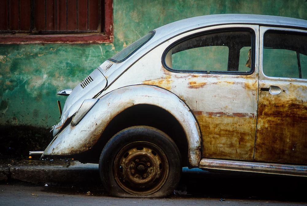 Broken down VW Bug in Centro Havana, Cuba.