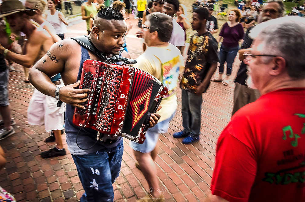 Dwayne Dopsie, down with the people, tearing it up at the 2014 Camden County Backyard BBQ. This was one of the last shots taken before everyone ran for cover as lightning strikes forced a pause and then the unfortunate scrapping of the remainer of the day's events.