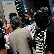 Rebel fighters carry the body of a comrade killed by snipper fire in central Zawiya.