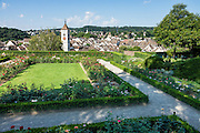 Rosengarten, the rose garden, is designed in French Renaissance style, next to the entrance of the Munot fortress in Schaffhausen, Switzerland, Europe. In the background rises the steeple of St. Johann Church.