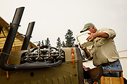 """Filling the radiator on the Curtiss JN-4D """"Jenny"""" at the 2017 Hood River Fly-In."""