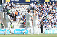 Mitchell Johnson of Australia congratulates Mitchell Starc of Australia for his wicket of Mark Wood of England   during the 3rd day of the Investec Ashes Test match between England and Australia at the Oval, London, United Kingdom on 22 August 2015. Photo by Phil Duncan.