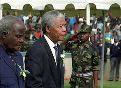 Nelson Mandela and Zambian President Kenneth Kaunda attend the vigil at Soweto stadium for assassinated ANC leader Chris Hani, 1993. Greg Marinovich