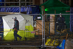 ©️ Licensed to London News Pictures. 05/02/2021. London,UK. Bailiffs work to evict a group of eco-activists at night, who are living in increasingly unstable tunnels beneath Euston Square Gardens in central London. The eviction of the HS2 Rebellion group from the square began more than a week ago and continues today.  Photo credit: Marcin Nowak/LNP