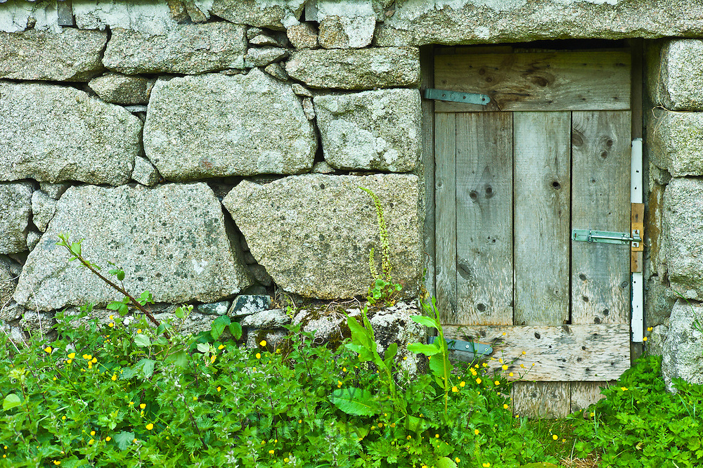 Old stone traditional cottage with block stones at Rosmuch, Connemara, County Galway, Ireland