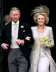 Prince Charles, the Prince of Wales, and Camilla the Duchess of Cornwall, leave St George's Chapel, Windsor, following the blessing of their wedding.