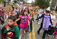 Pleasant Street School teachers dressed as varied Crayola crayons colored the streets of Laconia Wednesday afternoon along with their students for a festive Halloween parade.  (Karen Bobotas/for the Laconia Daily Sun)