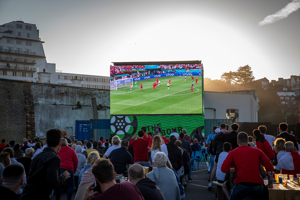 England fans watching the the Euro 2020 semi final match between England and Denmark on the 7th of July 2021 at the outdoor screen at Folkestone Harbour Arm, in Folkestone, United Kingdom. (photo by Andrew Aitchison / In pictures via Getty Images)
