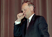 """Canadian Prime Minsiter Jean Chretien sucks on his thumb as he jokingly mocks a little girl at the premier of the annimated television series """"Pumper Pups"""" in Hull, Quebec, February 6, 2000."""