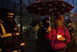 Environmental activists from HS2 Rebellion attend a candlelit vigil for the trees lost, or about to felled, for the HS2 high-speed rail project in Euston Square Gardens on 6 February 2021 in London, United Kingdom. The vigil took place alongside the site of a tunnel in Euston Square Gardens from which bailiffs contracted to HS2 Ltd have been trying to evict nine activists seeking to protect the trees for the past eleven days and also marked the first anniversary of the death of environmental activist Iggy Fox.