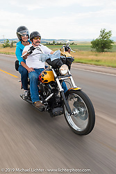 Danell and Stacy McCleary on the annual Michael Lichter - Sugar Bear Ride hosted by Jay Allen from the Easyriders Saloon during the Sturgis Black Hills Motorcycle Rally. SD, USA. Sunday, August 3, 2014.  Photography ©2014 Michael Lichter.