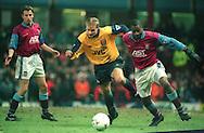 Dennis Bergkamp of Arsenal battles with Ugo Ehiogu of Aston Villa -  Coca Cola Cup Semi Final - Aston Villa v Arsenal - Villa Park Stadium - Birmingham - England - 21st  February 1996 - Picture Simon Bellis/Sportimage