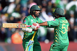 Pakistan captain Sarfraz Ahmed and Mohammad Amir (left) celebrate winning the ICC Champions Trophy, Group B match at Cardiff Wales Stadium.