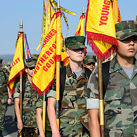 The Douglas County Young Marines from Colorado carry the colors along HW 264 for the Navajo Code Talkers Parade in Window Rock, AZ on Aug. 14, 2018.