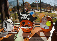 GHS decorates 48 pumpkins for contest.  (Karen Bobotas/for the Laconia Daily Sun)