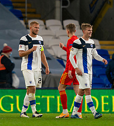 CARDIFF, WALES - Wednesday, November 18, 2020: Finland's substitute Juhani Ojala (R) and Paulus Arajuuri walk off dejected after the UEFA Nations League Group Stage League B Group 4 match between Wales and Finland at the Cardiff City Stadium. Wales won 3-1 and finished top of Group 4, winning promotion to League A. (Pic by David Rawcliffe/Propaganda)