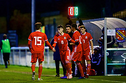 BANGOR, WALES - Tuesday, November 20, 2018: Wales' Brennan Johnson and Jack Vale are substituted for Dylan Levitta and Luke Jephcott during the UEFA Under-19 Championship 2019 Qualifying Group 4 match between Wales and San Marino at the Nantporth Stadium. (Pic by Paul Greenwood/Propaganda)