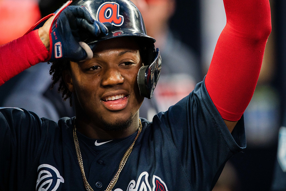 Ronald Acuna Jr. scores during Braves v. Reds exhibition game on Monday, March 25, 2018 at SunTrust Park. The Braves won 8-5. Photo by Kevin D. Liles/Atlanta Braves