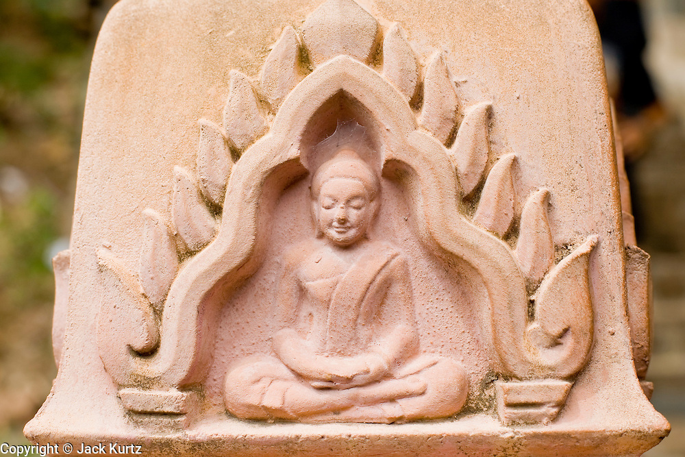 02 JULY 2006 - UDONG, CAMBODIA: A Buddha carved into the hand rail of the former royal citadel in Udong, Cambodia. The former citadel was abandoned when Cambodia was colonized by the French. Members of the royal family are buried there and it is now a revered place in Cambodia. Photo by Jack Kurtz / ZUMA Press
