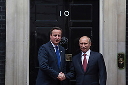 © licensed to London News Pictures. London, UK 02/08/2012. British Prime Minister David Cameron greeting President of Russia, Vladimir Vladimirovich Putin on Downing Street on 02/08/12. Photo credit: Tolga Akmen/LNP