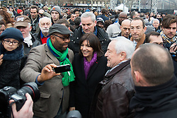 © Licensed to London News Pictures. 10/01/2016. France, Paris. The Paris Mayor Anne Hidalgo greets members of the public. French officials are joined by family members of the victims the 2015 Charlie Hebdo Shootings. Today January 10th 2016. Photo credit: Hugo Michiels/LNP