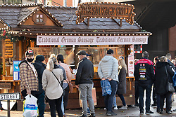© Licensed to London News Pictures. 06/12/2020. Lincoln, , UK. Lincoln Shopping. The first weekend of December shopping in Lincoln City Centre with the City in Tier 3 of Covid restrictions. The annual Lincoln Christmas market was cancelled this year to Covid, however there was still a queue for the German Sausage stall on St Marys Street in the City Centre. Photo credit: Dave Warren / LNP
