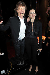 MICK JAGGER and L'WREN SCOTT at the opening of Jade Jagger's shop at 43 All Saints Road, London W11 on 25th November 2009.