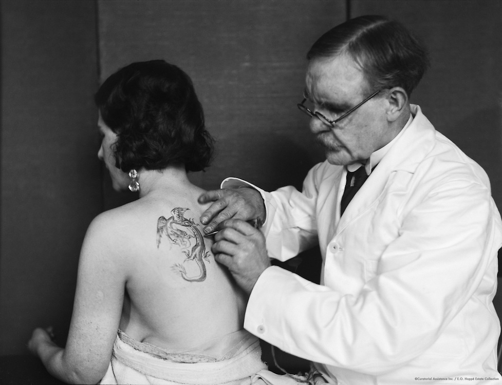 Tattooing a Woman's Back, England, 1931