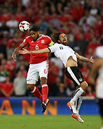 Ashley Williams of Wales (l) jumps for a header with Martin Harnik of Austria.Wales v Austria , FIFA World Cup qualifier , European group D match at the Cardiff city Stadium in Cardiff , South Wales on Saturday 2nd September 2017. pic by Andrew Orchard, Andrew Orchard sports photography