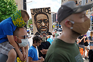 """A painting of George Floyd is shown as hundreds of protesters turned out June 7, 2020, for a Black Lives Matter """"Circle of Peace"""" protest at Centre Square in Easton, Pennsylvania. (Photo by Matt Smith)"""