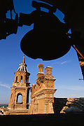 Stork nests on the Iglesia de San Miguel in Alfaro, Rioja, Spain.
