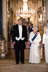 RETRANSMITTED CORRECTING BYLINE US President Donald Trump and Queen Elizabeth II during a group photo ahead of the State Banquet at Buckingham Palace, London, on day one of US President Donald Trump's three day state visit to the UK.