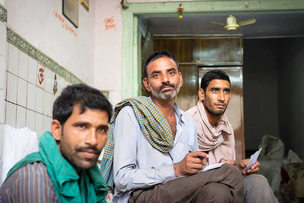 Group of Indian men in Chandni Chowk spice market, Old Delhi