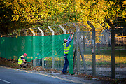 Fencing and security preparations take place at Napier Barracks to welcome Asylum seekers at the new assessment and dispersal facility for asylum seekers on 21st September 2020 in Folkestone, Kent, Untied Kingdom.  Napier barracks was recently taken over by the UK home office and is part of Shorncliffe military base.