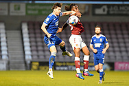 Ipswich Town defender Stephen Ward (3) battles for possession with Northampton Town defender (on loan from Luton Town) Peter Kioso (15) during the EFL Sky Bet League 1 match between Northampton Town and Ipswich Town at the PTS Academy Stadium, Northampton, England on 20 April 2021.