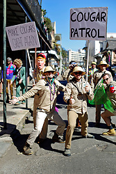 09 February 2016. New Orleans, Louisiana.<br /> Mardi Gras Day. Cougar Patrol. Some of the many bright and colourful costumes in the French Quarter. <br /> Photo©; Charlie Varley/varleypix.com