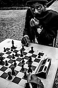 March 2015. Paris. A man playing chess on Luxembourg garden.