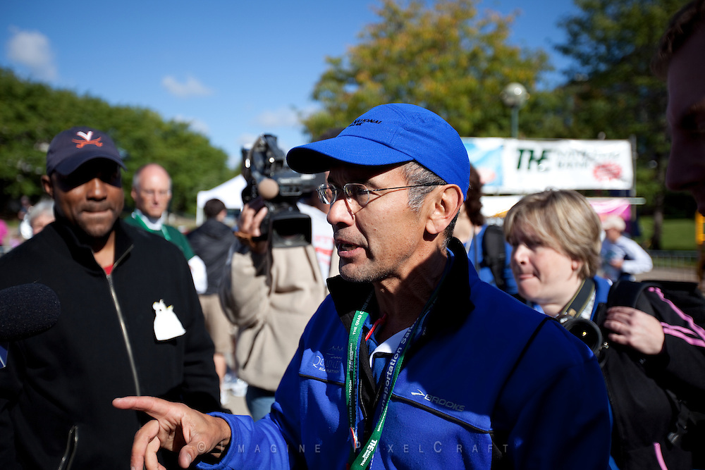 Race director Joe Moreno explains an issue to the media at the Quad Cities Marathon 2010.