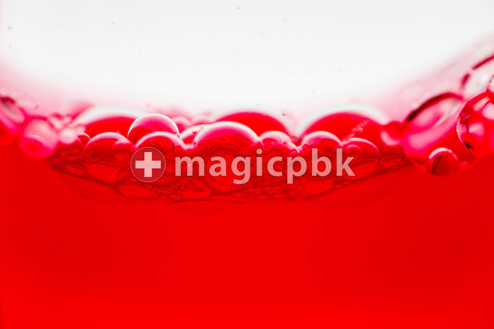 Bubbles seen in an Aura-Soma Equilibrium no. 55 (B55, Clear / Red) during a studio product photo session held at Aura-Soma Germany in Heiligenhaus, Germany, Saturday, Sept. 13, 2014. (Photo by Patrick B. Kraemer / MAGICPBK)